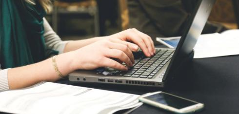 Woman typing writing on Laptop